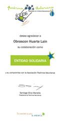 Imagen que muestra el diploma que Padrinos Asturianos ha entregado a OHL como entidad solidaria